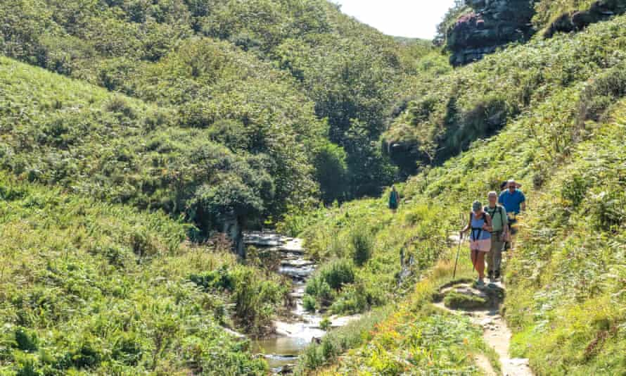 Group of hikers walking near Tintagel, Cornwall.