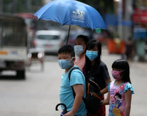 People wearing masks walk in downtown Yangon, Myanmar after 70 more Covid-19 cases were confirmed on Wednesday morning, the highest surge in a single day since the disease was first detected in the country.