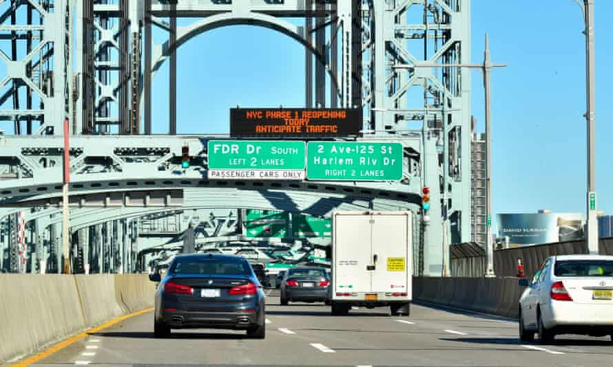 A road sign on the Robert F Kennedy Bridge states 'NYC Phase 1 Reopening Today Anticipate Traffic' on Monday.