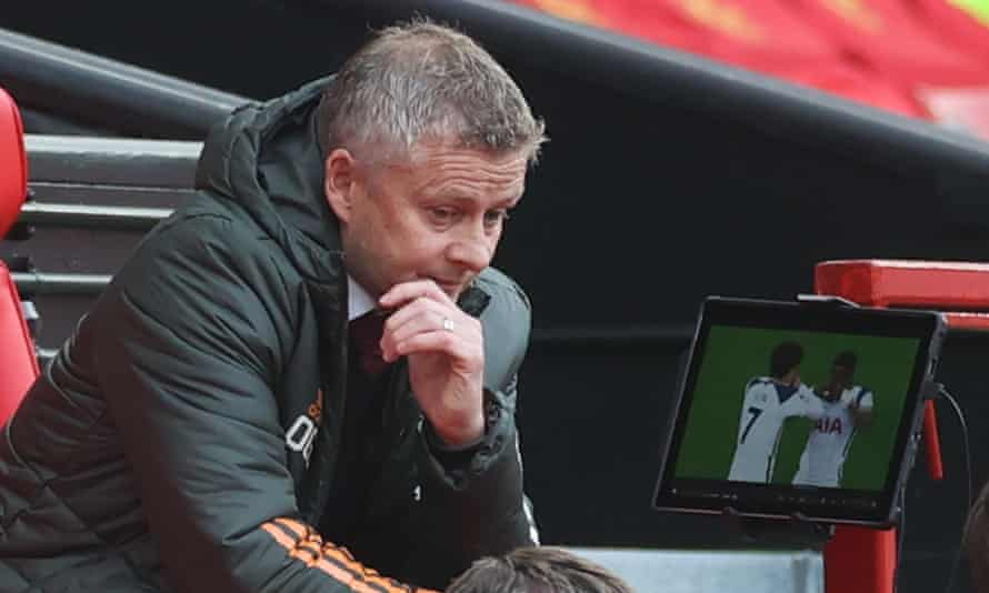A stunned Ole Gunnar Solskjær watches Son Heung-min celebrate Tottenham's fourth goal of their 6-1 win at Old Trafford