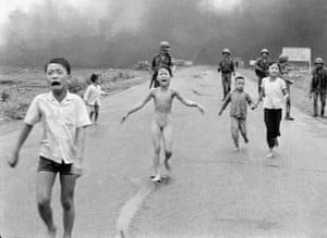Severely burned in an aerial napalm attack, children run screaming for help down Route 1 near Trang Bang, followed by soldiers of the South Vietnamese army's 25th Division, June 8, 1972