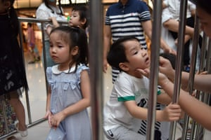 Child models Yumi (left) and Yuki Xiao prepare to take the stage