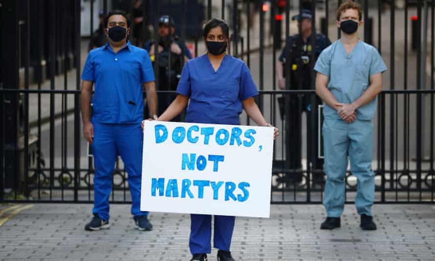 Medical staff protest at the gates of Downing Street after the last Clap for our Carers.