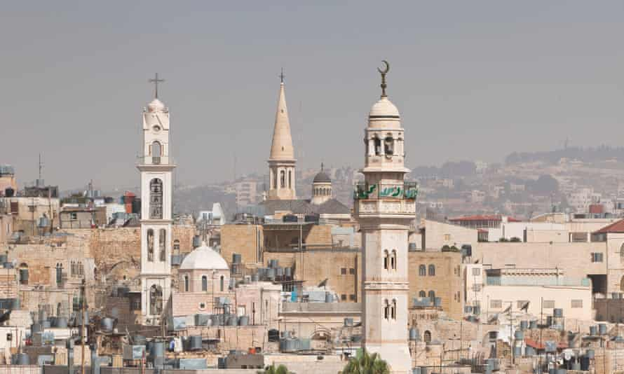 Skyline of Bethlehem, with a mosque's minaret and various churches, West Bank, Palestine