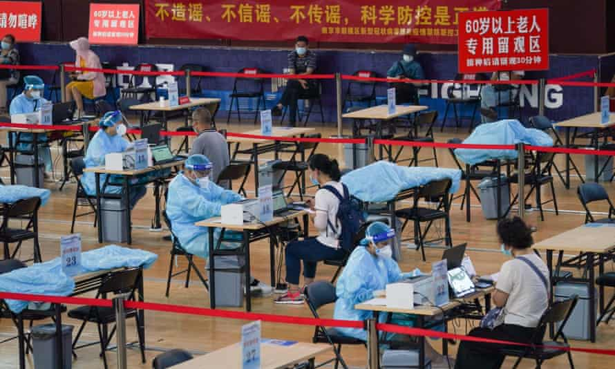 Residents register before being vaccinated against Covid-19 at a vaccination site at a stadium in Nanjing, the capital of east China's Jiangsu province.
