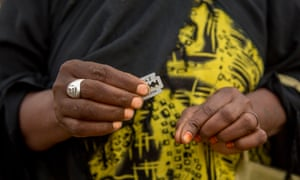 A woman in Hargeisa, the capital of Somaliand, shows a blade and homemade anti-bleeding powder typical of those used by practitioners of female genital mutilation