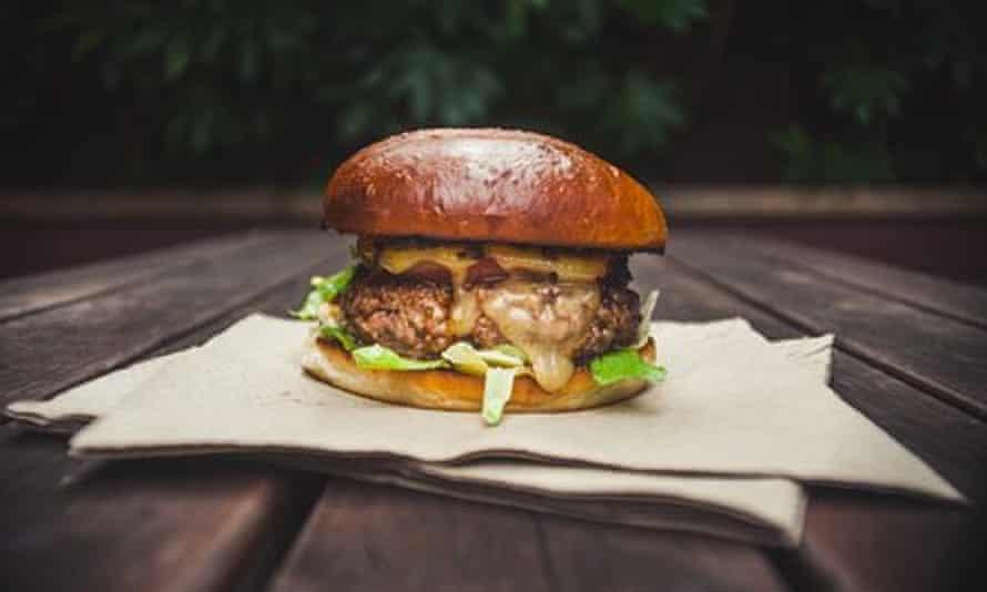 Burger on a napkin at The Troll's Pantry, Brighton, UK