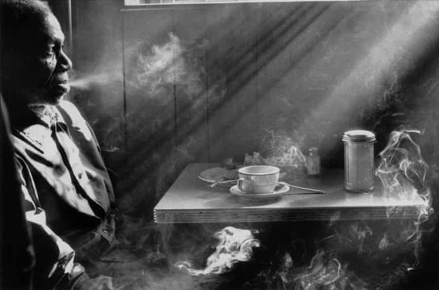 Man Smoking in Diner, 1974