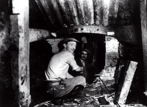 c1949. Workers digging the tunnel meet in the middle. Once complete the tunnels were used by more than 18,000 people a day, many of them shipyard workers