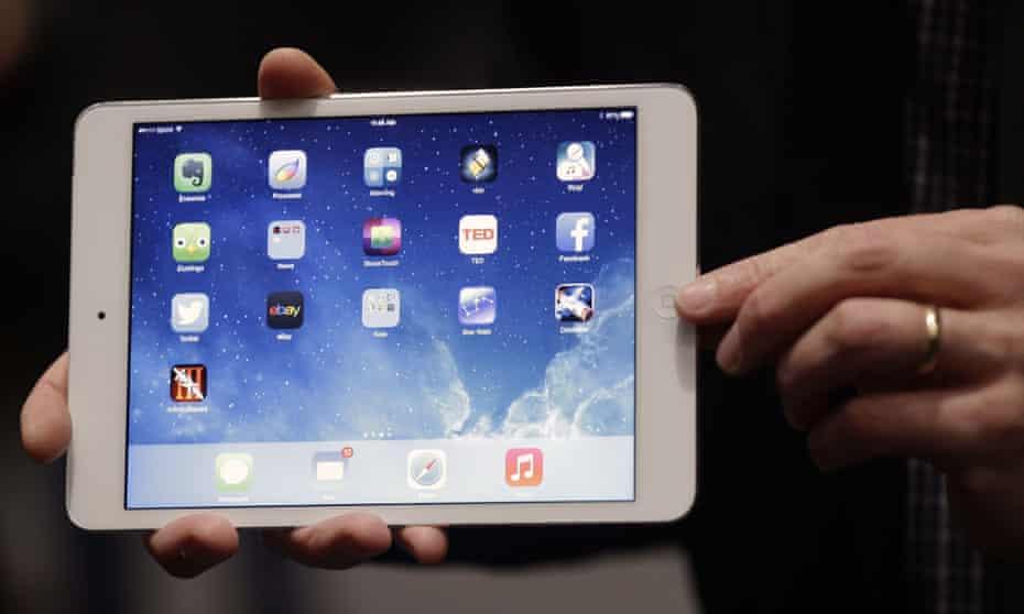 Apple employee demonstrates the new iPad Mini in San Francisco