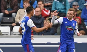 Ipswich players celebrate their second goal, which was credited to Swansea's Mike van der Hoorn.