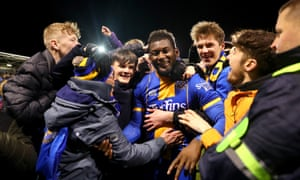 Shrewsbury's Aaron Pierre is mobbed by fans as he celebrates victory.