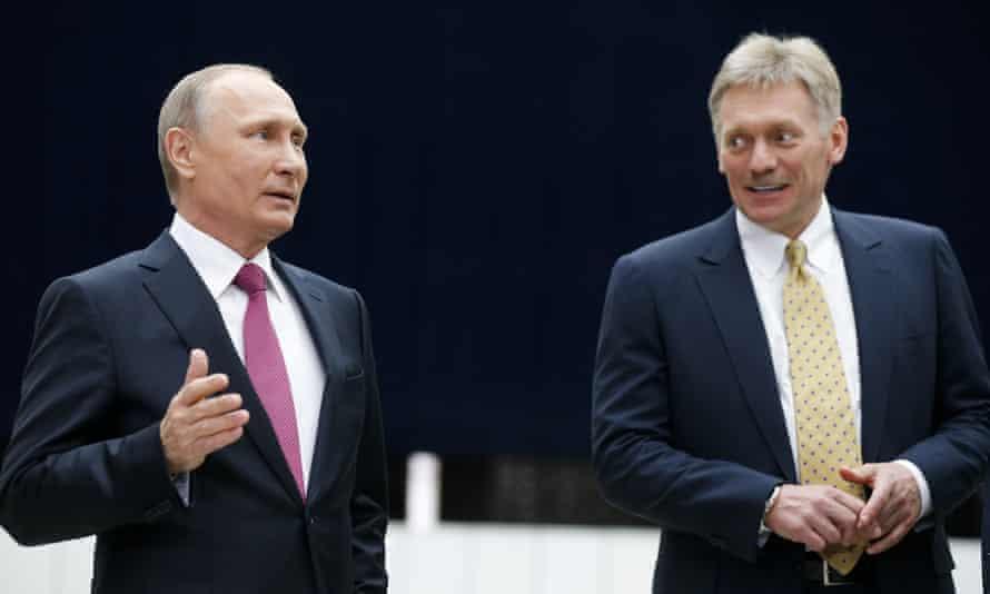 Dmitry Peskov seen with Vladimir Putin