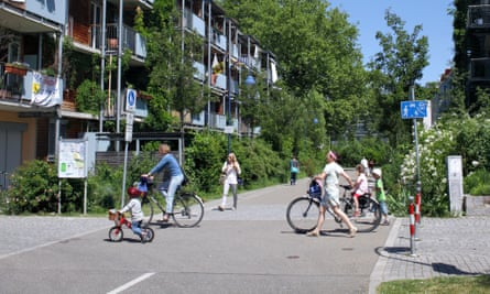 Housing and cyclists in the green suburb of Vauban, Freiburg, Germany.