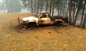 Erich and Christie Timko lost their home and pickup as the Canyon Creek Complex fire advanced on Saturday.