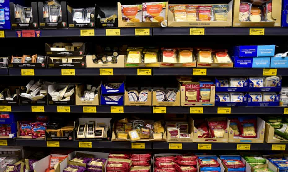 A range of cheese on display in Aldi.