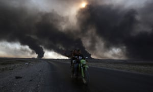 Sunni fighters ride a motorcycle