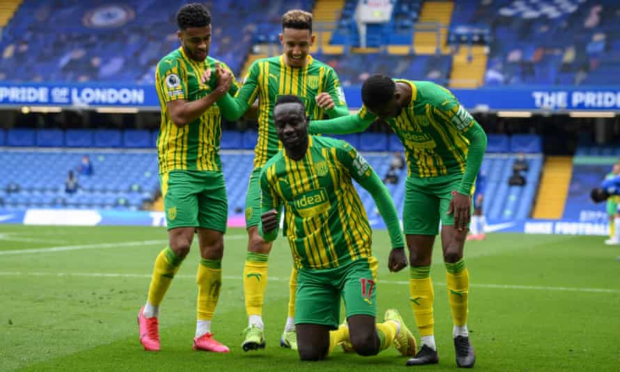 West Bromwich Albion's Mbaye Diagne celebrates scoring their fourth goal with teammates.