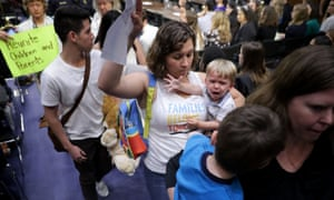 Activists stand and walk out of a Senate judiciary committee hearing about the separation of children from their parents at the border on 31 July.