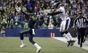 Seattle's Paul Richardson, left, has his helmet pulled back as Philadelphia Eagles' Ronald Darby makes contact