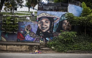 The city's bleak past seems far away as tourists join walking tours to view street art