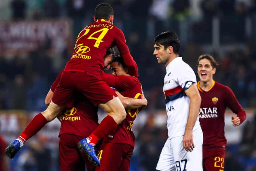 Roma players celebrate going 3-2 up on Genoa.