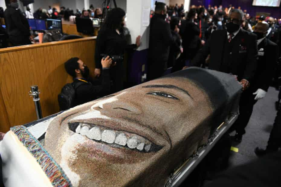 Daunte Wright's casket is escorted out following a funeral in Minneapolis on Thursday.
