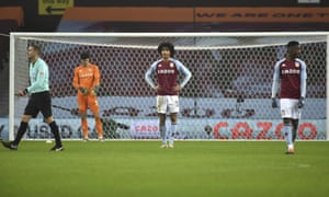 Aston Villa's players are dejected after Liverpool's Mohamed Salah scored his team's fourth goal.