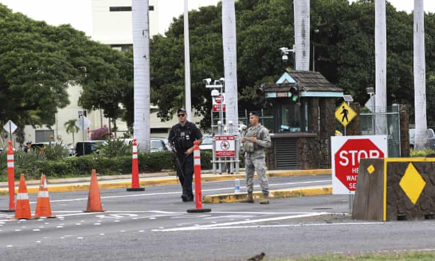 Security stands outside the main gate at Joint Base Pearl Harbor-Hickam on Wednesday.
