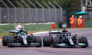 Lance Stroll is overtaken by Lewis Hamilton