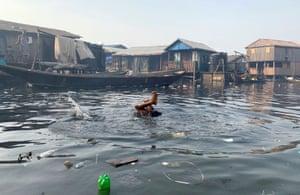 A boy swims in polluted waters in the Makoko neighbourhood in Lagos, Nigeria