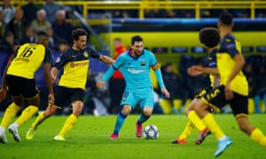 Lionel Messi evades several Dortmund players during a Champions League game.