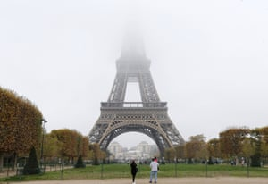 Fog and smog swallow up the top of the Eiffel Tower in Paris
