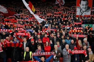 Fans on the Kop sing You'll Never Walk Alone before Liverpool's Premier League match against Huddersfield at Anfield in April 2019.
