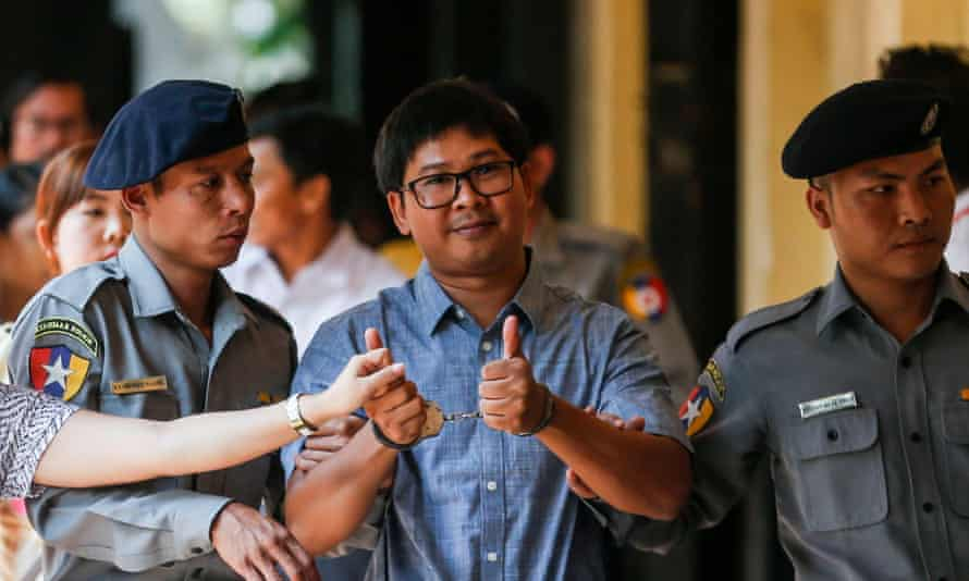 Reuters journalist Wa Lone is escorted to court in Yangon