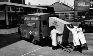 A National-Elliot 803 computer being loaded onto a customised Austin 32 cwt van at the Boreham Wood factory of Elliott-Automation, bound for Moscow.