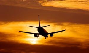 Aeroplane landing at sunset