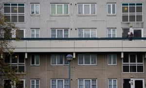 A man looks out on the Broadwater Farm housing estate in Haringey, north London.