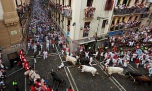 Revellers run with Jandilla fighting bulls in Pamplona