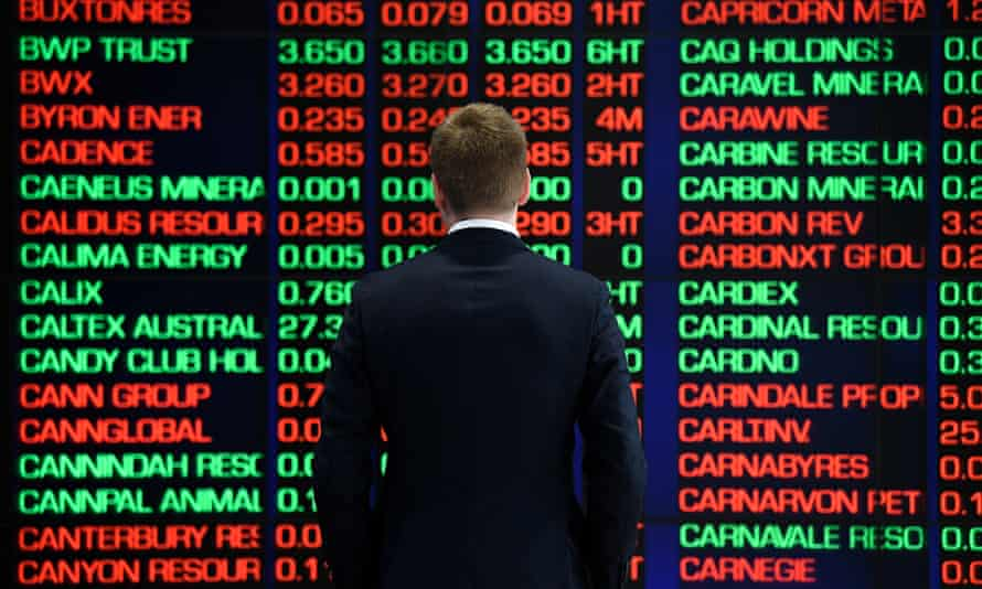 A man looks at the ASX boards