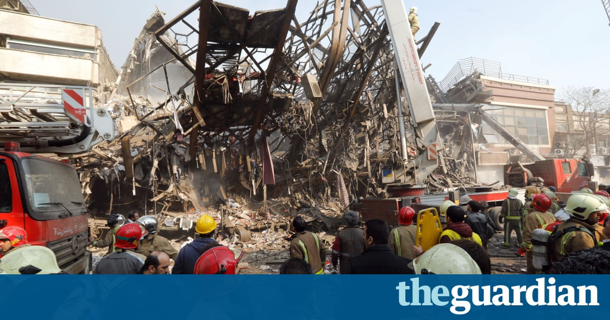Tehran fire: dozens of firefighters killed after tower collapses