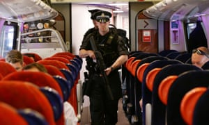 Armed British Transport Police Specialist Operations officers on board a Virgin train