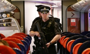 Armed British Transport police specialist officers on board a train to Birmingham New Street.