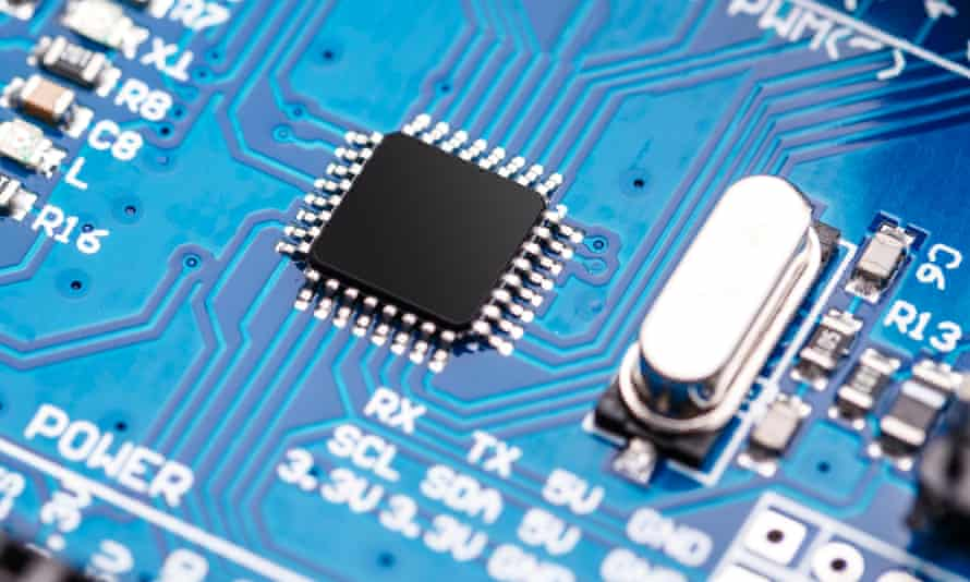 A semiconductor microchip and microprocessor on a blue circuit board