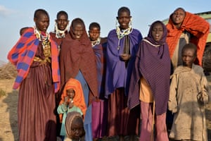 A group of Maasai people in a portrait shot. The Maasai living in the region are a semi-nomadic people predominantly reliant on livestock herding, who face a number of challenges to their way of life from ongoing land-grabs for game reserves and the expansion of the ecotourism industry.