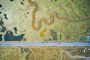 road through wetland landscape