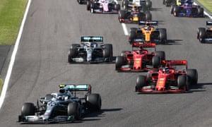 Valtteri Bottas (bottom left) overtook Ferrari's Sebastian Vettel into the first turn of Lap 1.