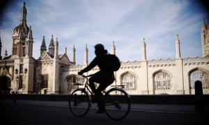 A cyclist travels along King's Parade, with King's College, Cambridge, providing a backdrop.