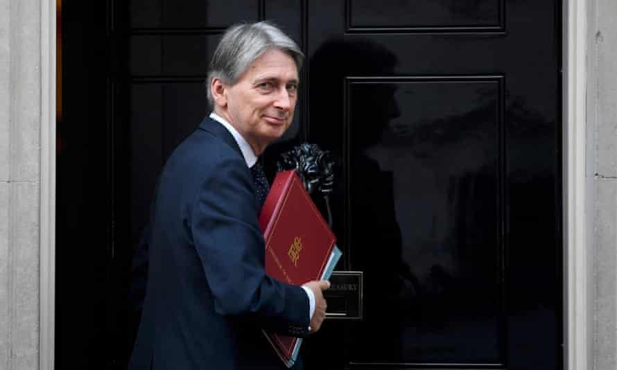 Philip Hammond entering 10 Downing Street