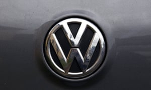 A Volkswagen logo is seen on one of the German automaker's cars in a street in Sydney, Australia, October 8 2015.